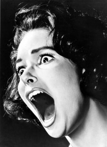 black and white photo from the fifties of woman screaming